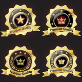 Set of Golden Premium Quality Badge. With stars design Royalty Free Stock Photos