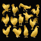 Set of golden rooster on a black background. Set of silhouettes of gold rooster on a black background. Cock symbol of the new year on the Chinese Royalty Free Stock Images