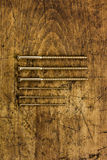 Set of golden screws on wooden background. Symbolic repair tool Stock Photo