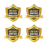 Set Of Golden Shield Stickers Money Back Guarantee Label With Ribbon Isolated Royalty Free Stock Photo