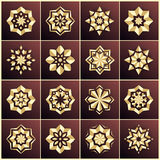 Set of golden snowflakes. Set of gold stars. The bulk of the star. Christmas star. Mandala. Stock Images