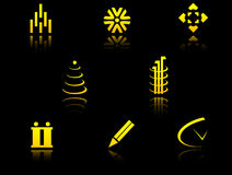 Set of golden symbols. On black with reflection Stock Photos