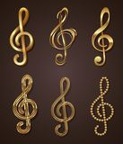 Set of golden treble clef Stock Photos