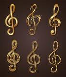 Set of golden treble clef Stock Photos