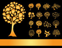 Set of 16 golden tree silhouettes Royalty Free Stock Photo