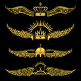 Set of golden winged crowns logos black background Royalty Free Stock Image