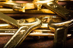 Set of golden wrenches on rusty background. Repair tools Royalty Free Stock Image