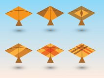 A set of golden and yellow kites for children play with different designs. Vector illustration vector illustration