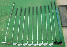 Set of golf clubs. On green bottom Royalty Free Stock Images
