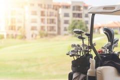Set of golf clubs on golf cart on a golf course. Set of golf clubs on golf cart on a golf field stock photo