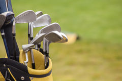 Set of golf clubs over green field Stock Images