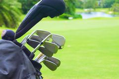 Set of golf clubs over green field background. Set of golf clubs over green Stock Photo