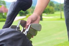 Set of golf clubs over green field background. Set of golf clubs over green Royalty Free Stock Photos