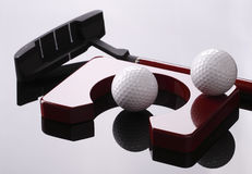 Set for golf, golfclub, balls and hole. Set for golf, golfclub balls and hole on the black mirror Stock Images