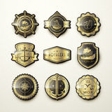 Set of gorgeous golden marine emblems Royalty Free Stock Photography