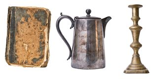 Set of 3 gorgeous old vintage items. Book, candlestic, teapot. Isolated on white background stock image