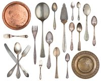 Set of 20 gorgeous old vintage items. Old silverware, spoons, forks, metal plates Isolated on white background stock images