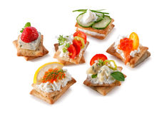 Set of gourmet crackers snacks close-up isolated on white Stock Photos