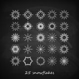 Set of 25  graceful snowflakes on the blackboard background Stock Photo