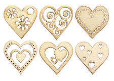 Set of graceful wooden hearts. With a burned pattern, isolated on white Stock Photos