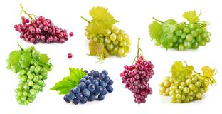 Set grape with green leaves healthy eating, on white background. Royalty Free Stock Images