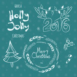 Set of graphic Christmas tags with wreath, deer horns pine tree and hand drawn letters Royalty Free Stock Photography