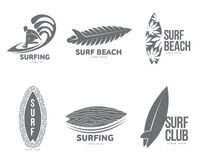 Set of graphic surfing logo templates with surfer and surfboard Royalty Free Stock Photo