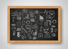 Set of graphics and pictures about economics statistics painted on chalkboard in frame Stock Photos