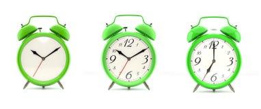 Set of 4 green alarm clocks Royalty Free Stock Photos