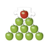 Missing top of hierarchy. Set of 9 green apples of the same shape and size set in a pyramid shape, missing the puzzle of the most important element - a chief red Stock Photos