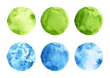 Set of green and blue watercolor circles on white. Set of green and blue watercolor hand painted circles isolated on white. Watercolor Illustration for artistic Royalty Free Stock Photo