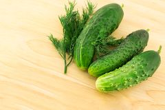 Set of green fruits vegetables cucumbers background fresh bright on wooden cutting board making up salad stock photo