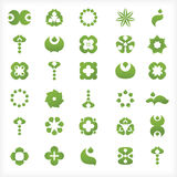 Set of 30  green icons and graphics. 30 icons, with various leaf and drop shapes,  symbols, and abstract shapes Stock Photos