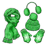 Set of green knotted scarf, hat, ear muffs and mittens Stock Images