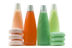 Set of Green, Red And Pink Hygienic Supplie. Shampoo and conditioner in bottles with qualitative soap bars; on white stock image