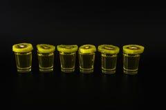 Set of green shots, green kamikaze, fresh kiwi fruit slices, bla Royalty Free Stock Images