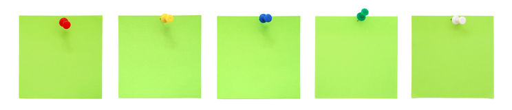 Set of green sticky notes with pushpins royalty free stock image