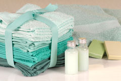 Set of green towels, soap and shampoo Stock Photo