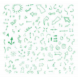 Set of green vector hand drawn arrows. Vector hand drawn arrows set written with green ink on paper Stock Photography