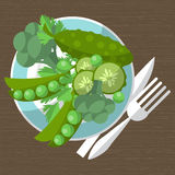 Set of green vegetables on a plate with a fork and knife. Vector Stock Photo