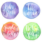 Set of Greeting Christmas cards with hand-drawn typography lettering phrases Holly Jolly, HoHoHo, Hello santa, Jingle bells on wat. Set of Greeting Christmas Stock Photos