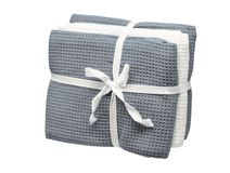 Set of grey and white towels isolated on white background. Close up, high resolution Stock Photo