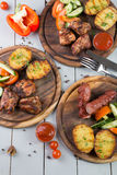 Set of grilled meat. Served with vegetables Stock Photo