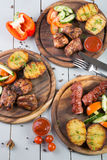 Set of grilled meat. Served with vegetables Stock Photos