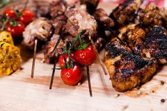 Set of grilled meat on wooden board Royalty Free Stock Photo