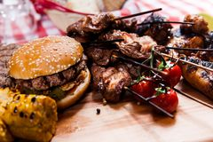 Set of grilled meat on wooden board Stock Photography