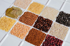 Set of groceries laying horizontal perspective. Barley grits, vermicelli, rice, sunflower seeds, bay leafs, buckwheat, roasted coffee beans, pearl barley Royalty Free Stock Images