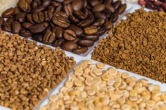 Set of groceries laying horizontal perspective with limited depth of field. Roasted coffee beans, freeze-dried instant coffee, buckwheat, dried peas.v Stock Photography