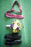 Set of groom clothes. Wedding rings, shoes, cufflinks and bow tie detalis fashion.  Stock Photo