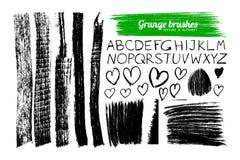 Set of grunge brushes and alphabet Stock Image
